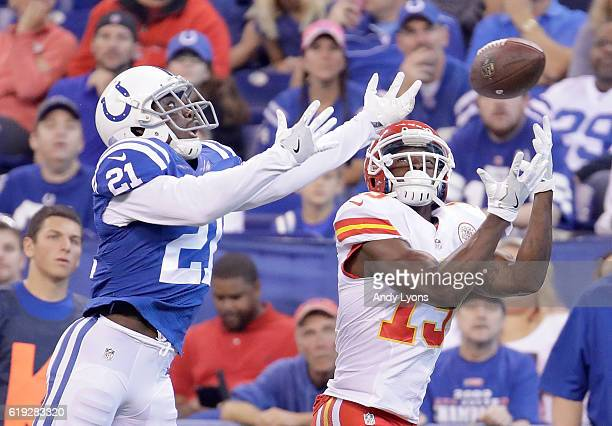 De'Anthony Thomas of the Kansas City Chiefs attempts to catch a pass while being guarded by Vontae Davis of the Indianapolis Colts during the first...