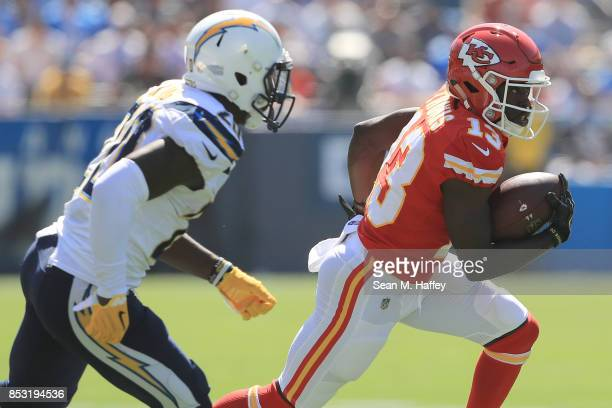 De'Anthony Thomas of the Kansas City Chiefs gets around Desmond King of the Los Angeles Chargers during the NFL game at the StubHub Center on...