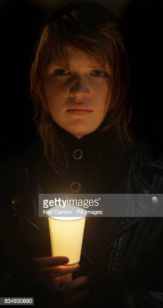 Deargh Armstrong whose sister Evelyn died from cervical cancer takes part in a candlelit vigil outside Leinster House in Dublin tonight as part of...