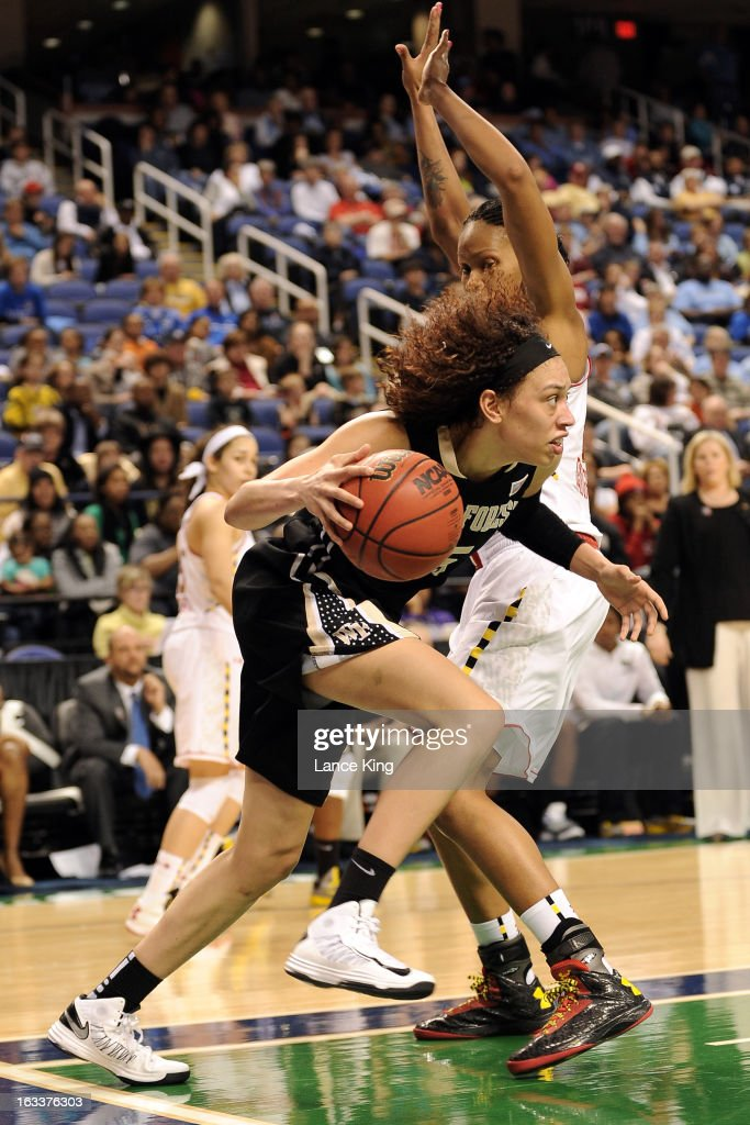 Dearica Hamby #25 of the Wake Forest Demon Deacons dribbles against Alicia DeVaughn #13 of the Maryland Terrapins during the quarterfinals of the 2013 Women's ACC Tournament at the Greensboro Coliseum on March 8, 2013 in Greensboro, North Carolina.