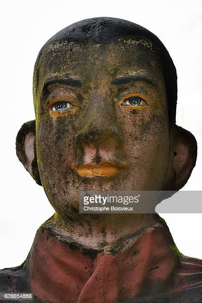 Deatail of face of wooden Monk statue.