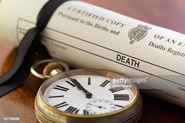 Death Certificate and Pocket Watch at Midnight