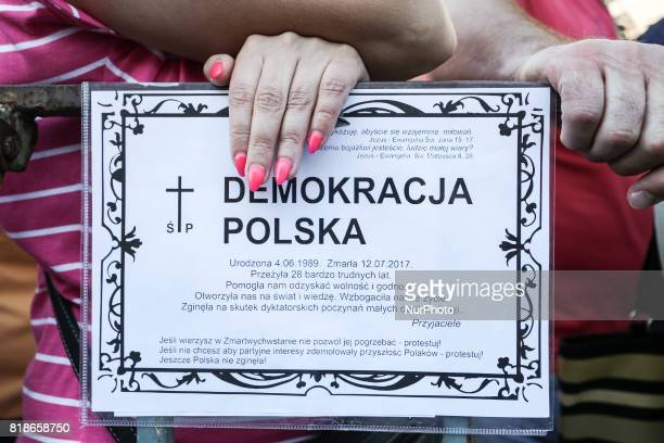 A death notic banner of Polish democracy during another day of protests against government plans for sweeping changes to Polands judicial system...