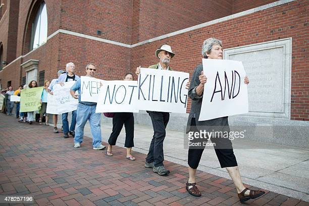 Death penalty protesters outside of John Joseph Moakley United States Courthouse during the official sentencing of Boston Marathon Bomber Dzhokar...