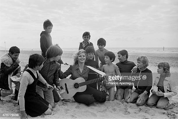 Deauville France Jane Manson singing on the beach