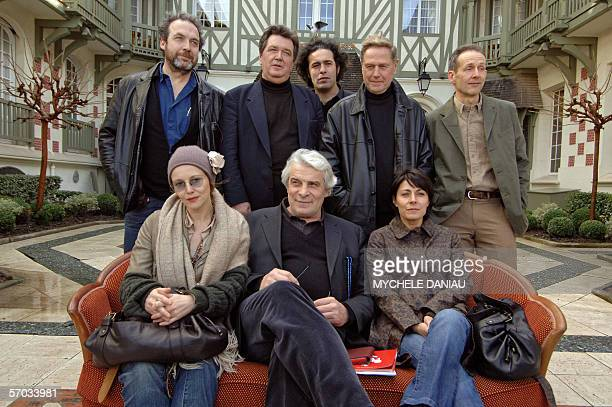 Members of the 8th Asian film festival Jury pose 09 March 2006 in Deauville Normandy From left to right on top French producer screenwriter and film...