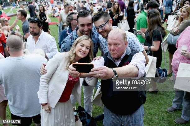 CEO Deb Dugan and chef Mario Batali pose with guests at EAT Food Film Fest at Bryant Park on June 20 2017 in New York City Photo by Nicholas...