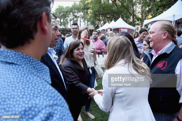 CEO Deb Dugan greets chefs Ina Garten and Mario Batali during EAT Food Film Fest at Bryant Park on June 20 2017 in New York City Photo by Nicholas...