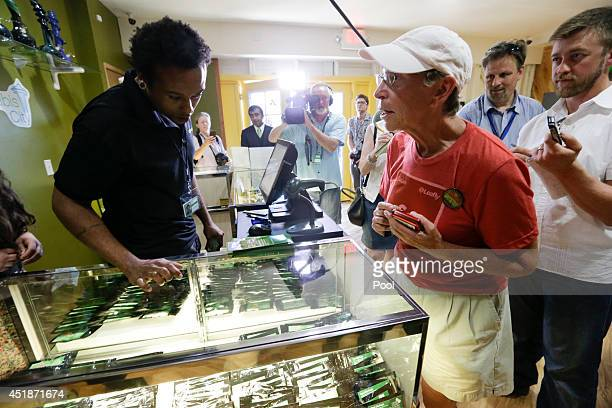 Deb Greene the first customer at the Cannabis City retail marijuana store buys marijuana on July 8 2014 in Seattle Washington Cannabis City was the...