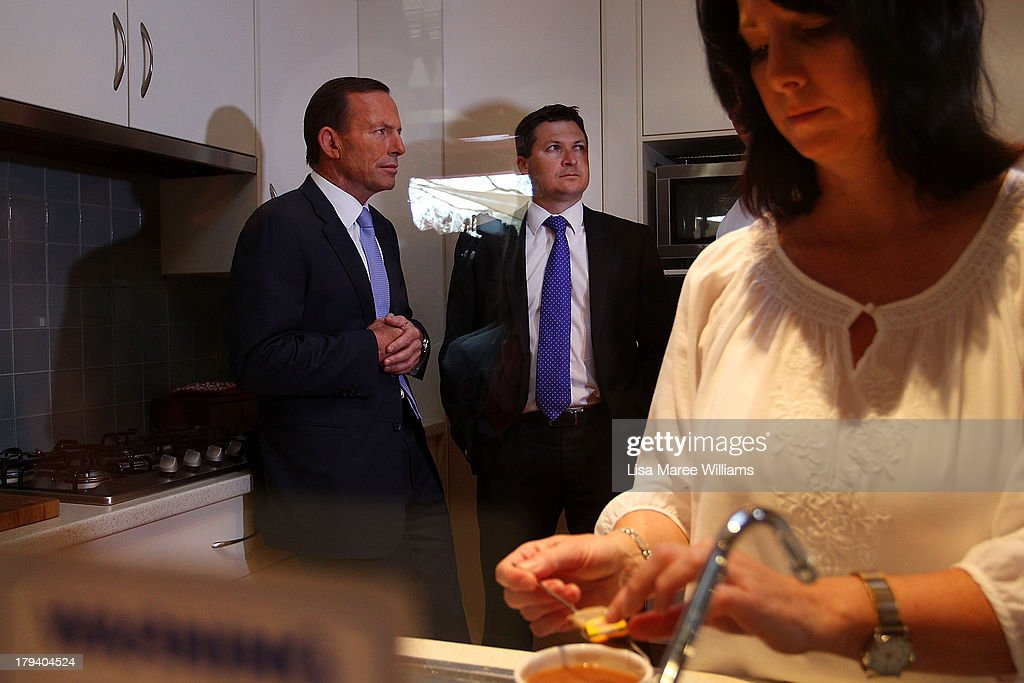 Deb Schmusch makes a coffee for Australian Opposition Leader, <a gi-track='captionPersonalityLinkClicked' href=/galleries/search?phrase=Tony+Abbott&family=editorial&specificpeople=220956 ng-click='$event.stopPropagation()'>Tony Abbott</a> at her home on September 3, 2013 in Adelaide, Australia. In the 2010 election the Australian Labor Party recorded its highest two-party-preferred vote since 1969 in South Australia, but if nationwide polling proves accurate the Liberal-National Party coalition believe they can gain seats in the state. (Photo