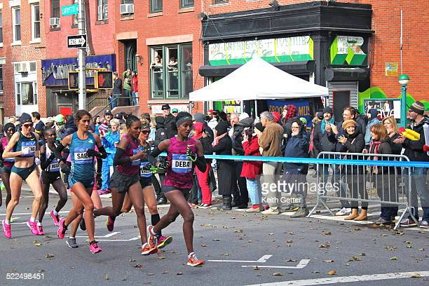 Deba in front of the Pack with other Lead Women Runners in NYC Marathon near the 8 mile area in Fort Greene Brooklyn NYC on Lafayette Avenue with...