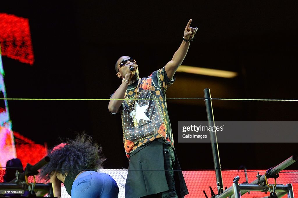 Debanji of Nigeria performs during the Nelson Mandela Sports & Cultural day music concert at the FNB Stadium on August 17, 2013 in Soweto, South Africa. The event is a tribute to honour the life of former president Nelson Mandela. Nelson Mandela is still in the Medi-Clinic Heart Hospital in Pretoria in a critical but stable condition.