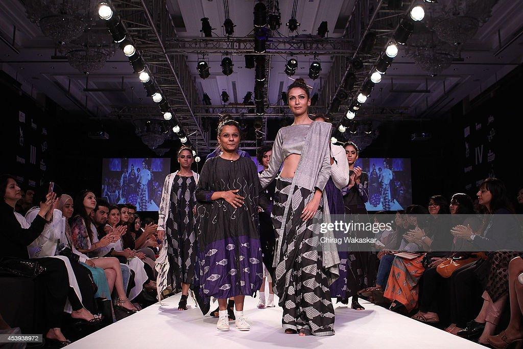 Debashri Samanta walks the runway during day 2 of Lakme Fashion Week Winter/Festive 2014 at The Palladium Hotel on August 21, 2014 in Mumbai, India.
