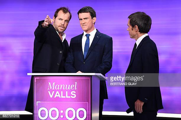 Debate director Tristan Carne gestures next to former French prime minister and candidate in the leftwing primary for the 2017 French presidential...