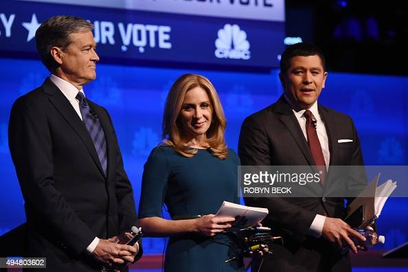 Debate moderators John Harwood Becky Quick and Carl Quintanilla take the stage at the third Republican Presidential Debate hosted by CNBC October 28...