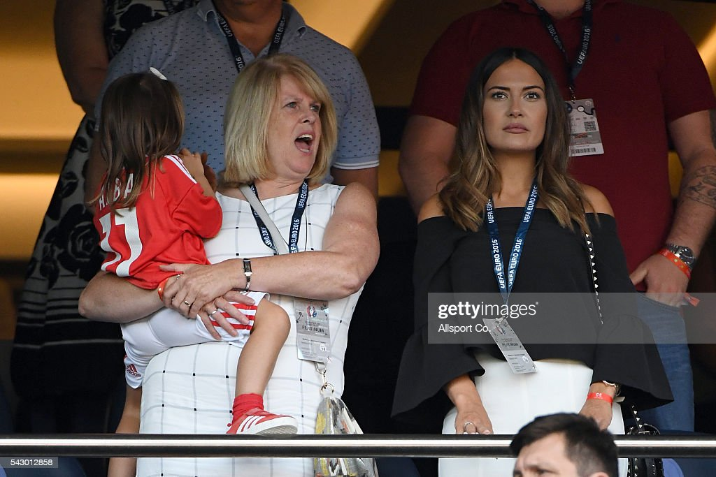 Debbie Bale, mother of Gareth Bale, Emma Rhys-Jones, wife of Gareth Bale (R)) and their daughter Alba Violet Bale attend the UEFA EURO 2016 round of 16 match between Wales and Northern Ireland at Parc des Princes on June 25, 2016 in Paris, France.