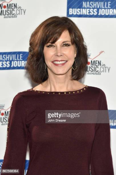 Debbie Carroll of MusiCares arrives at the 2017 Nashville Business Journal Women In Music City on October 17 2017 in Nashville Tennessee
