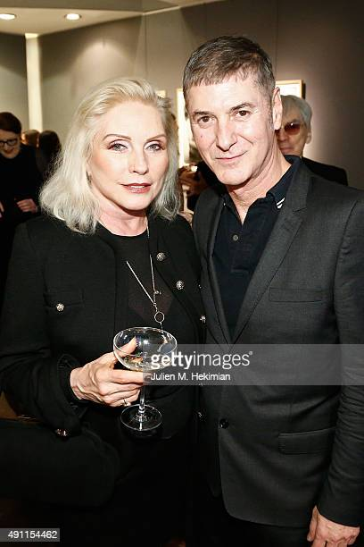 Debbie Harry and Etienne Daho attend the Chris Stein 'Negative' Exhibition Opening at Galerie Agnes Monplaisir on October 3 2015 in Paris France