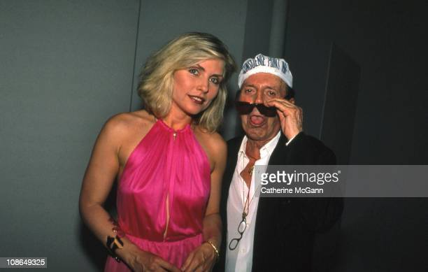 Debbie Harry and Francesco Scavullo pose for a photo at Hair Cares benefit on August 10 1988 in New York City New York