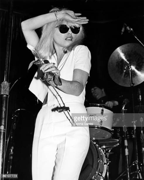 Debbie Harry of Blondie performs on stage holding a flower at the Whisky A Go Go Los Angeles California United States 1977