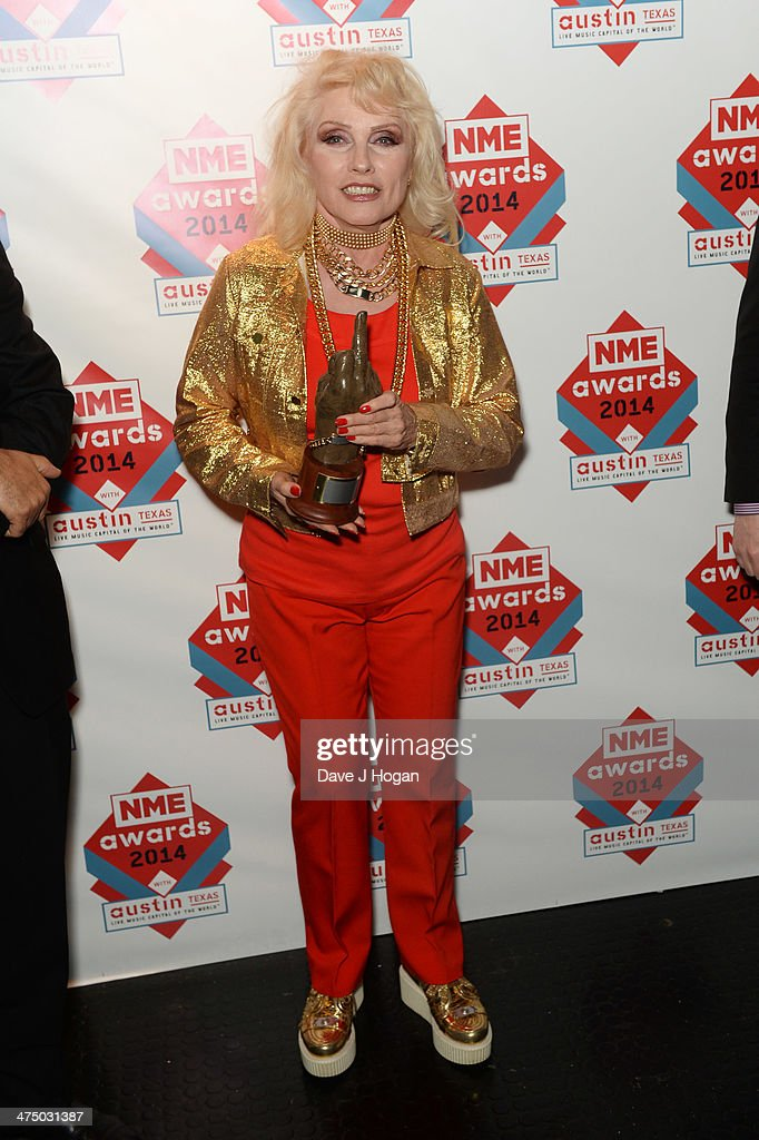 Debbie Harry poses with her Godlike Genius Award at the annual NME Awards at Brixton Academy on February 26 2014 in London England