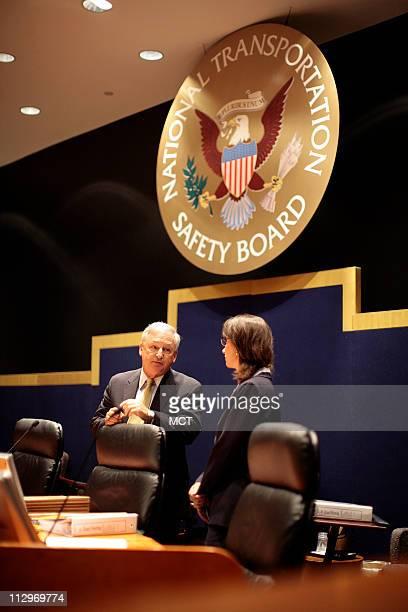 Debbie Hersman speaks with Chairman Mark V Rosenker before an NTSB meeting on the Lexington Kentucky crash investigation on Comair Flight 5191...