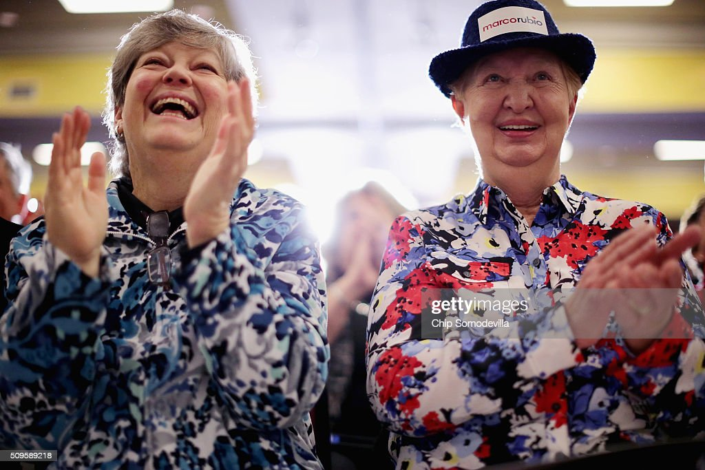 Debbie Hollister (L) and Beverly Gail cheer while listening to Republican presidential candidate Sen. Marco Rubio (R-FL) during a campaign town hall meeting at the Crown Reef Beach Resort February 11, 2016 in Myrtle Beach, South Carolina. Earlier in the week Rubio placed fifth in the New Hampshire primary, behind fellow GOP candidates Jeb Bush, John Kasich, Sen. Ted Cruz (R-TX) and Donald Trump, who won with 35 percent of the vote.