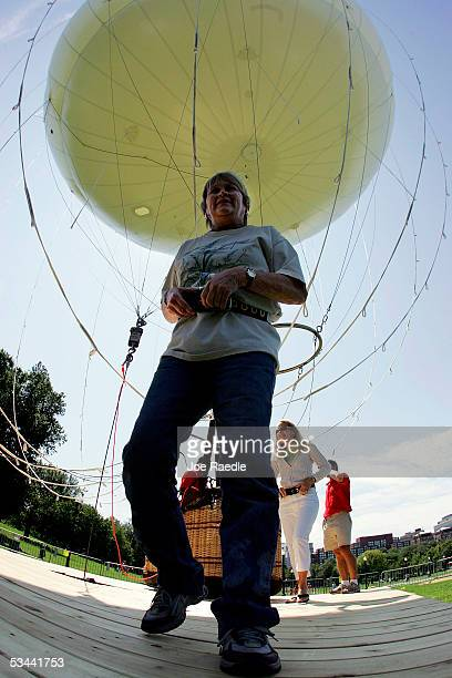 Debbie Loper walks away after a ride in the AeroBalloon USA's giant helium balloon on the grounds of the Boston Commons August 19 2005 in Boston...