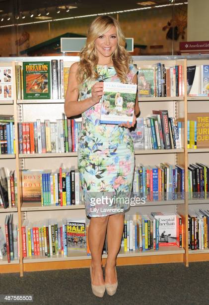 Debbie Matenopoulos poses with her book 'It's All Greek To Me' at Barnes Noble bookstore at The Grove on April 30 2014 in Los Angeles California