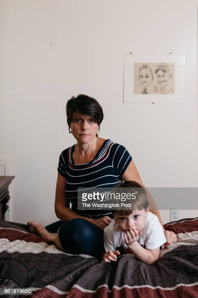 Debbie McLaughlin of Greenbush Me sits for a portrait with her 3yearold grandson who is in foster care in her bedroom on Friday June 30 2017...
