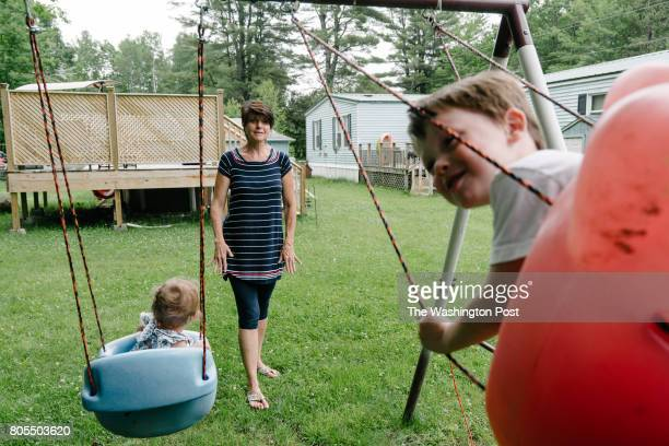 Debbie McLaughlin of Greenbush Me swings an infant and her 3yearold grandson both in foster care her backyard on Friday June 30 2017 McLaughlin and...