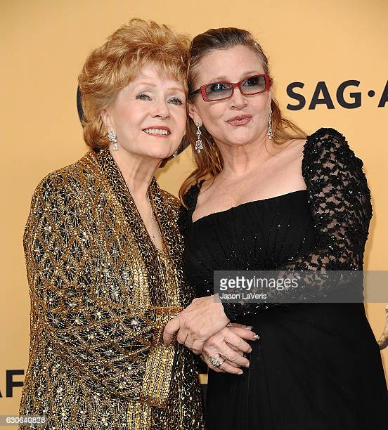 Debbie Reynolds and Carrie Fisher pose in the press room at the 21st annual Screen Actors Guild Awards at The Shrine Auditorium on January 25 2015 in...