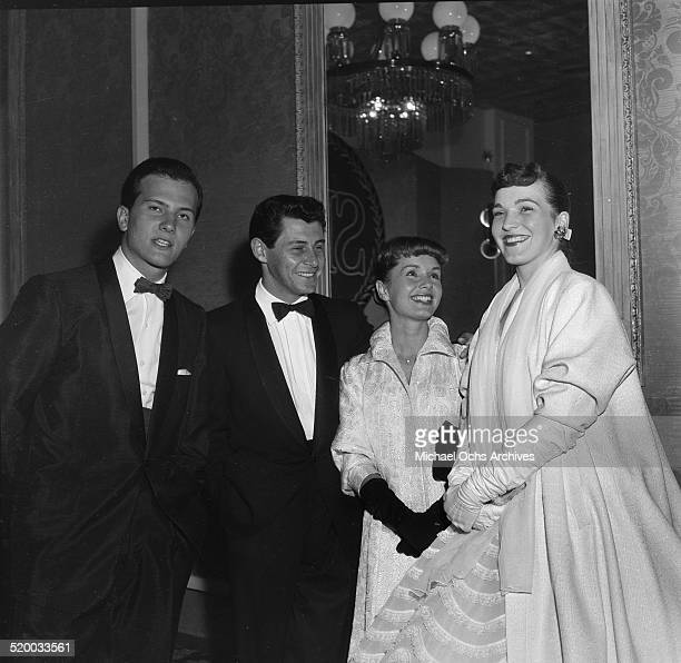 Debbie Reynolds and Eddie Fisher poses with Pat Boon and his wife as they attend the Screen Producers Awards in Los AngelesCA