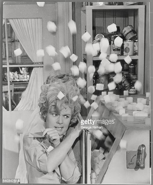 Debbie Reynolds battles icecube machine that has gone wild in this scene of My Six Loves Par directed by Gower Champion
