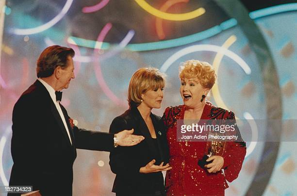 Debbie Reynolds Carrie Fisher and Donald O'Connor at the American Comedy Awards on February 9 1997 at the Shrine Auditorium in Los Angeles California
