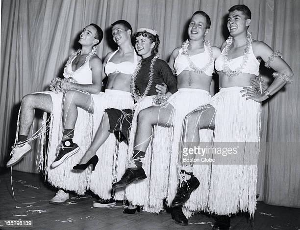Debbie Reynolds dances in a chorus line with Hasty Pudding Theatricals members left to right Bernie Gross Newark NJ Nat Cooke NYC Roger Christenfeld...