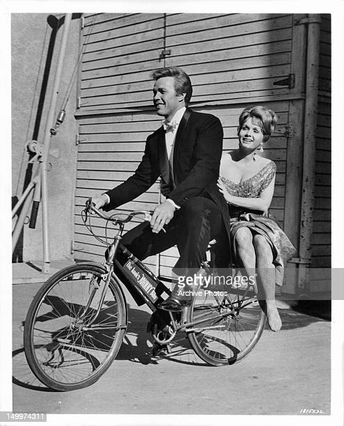 Debbie Reynolds gets taken for a ride by Harve Presnell on the set of the film 'The Unsinkable Molly Brown' 1964