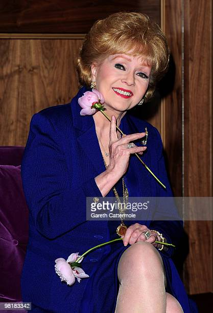 Debbie Reynolds poses during a photocall to promote her UK tour 'Alive and Fabulous' on her 78th birthday at The Sofitel Hotel St James on April 1...