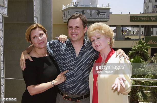 Debbie Reynolds with her children Carrie and Todd Fisher on the site of the new museum that will house her collection of film costumes