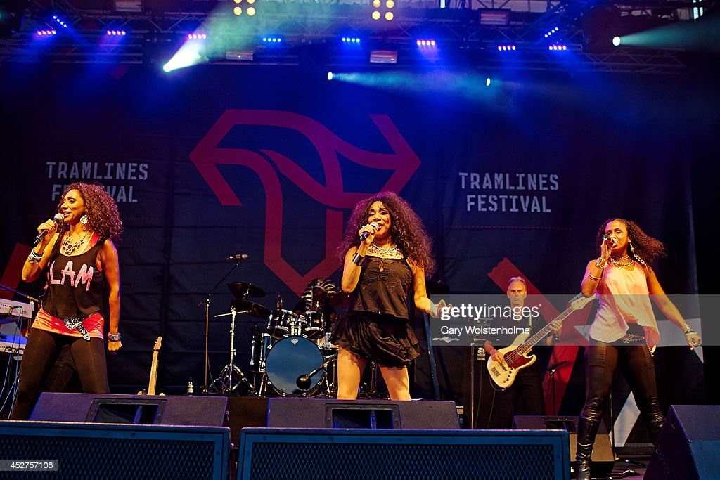 Debbie Sledge, Joni Sledge and Kim Sledge of Sister Sledge performs on stage at Tramlines Festival at Devonshire Green on July 26, 2014 in Sheffield, United Kingdom.