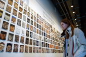 Debbie Visco a Syracuse University student looks portraits of US soldiers killed in Iraq on the first day of the exhibition 'To Never Forget The...