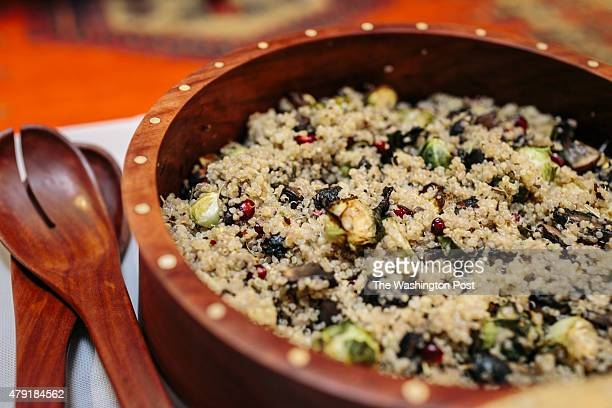 Debbie Wasserman Schultz prepares roasted brussel sprout and pomegranate quinoa to share with the Vegetarian Lunch Club she is a member of at the...