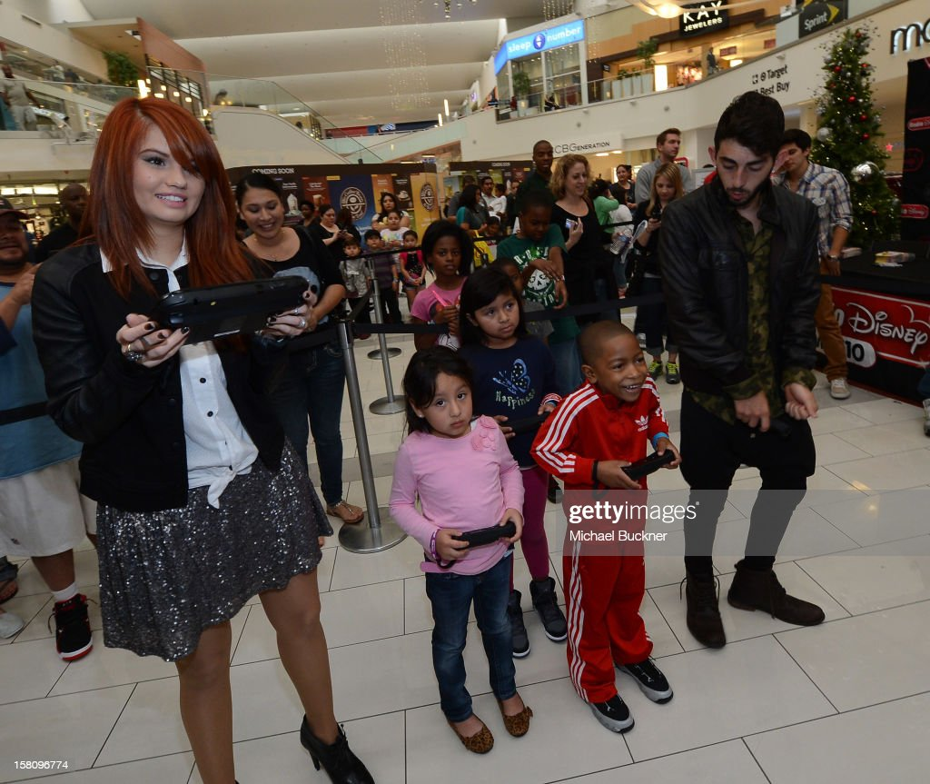 Debby Ryan (L) and Mateo Arias stars of Disney XD's hit series 'Kickin' It' gets ready to battle in the Wii U Showdown at Westfield Century City Mall in Los Angeles on December 9, 2012. Wii U is one of Nintendo's hottest items of the holiday season.