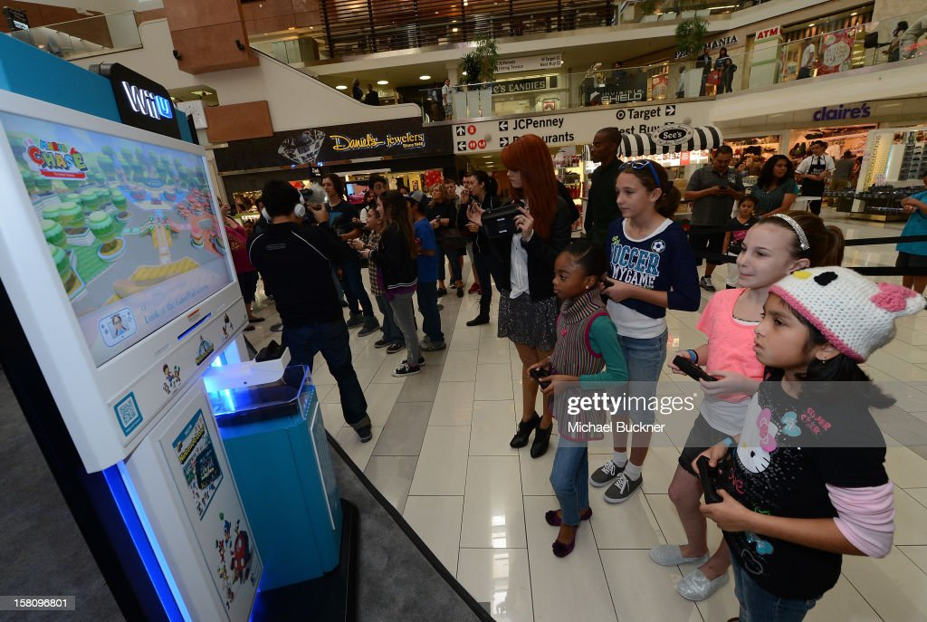 Debby Ryan (L) and Skai Jackson stars of Disney XD's hit series 'Kickin' It' gets ready to battle in the Wii U Showdown at Westfield Century City Mall in Los Angeles on December 9, 2012. Wii U is one of Nintendo's hottest items of the holiday season.