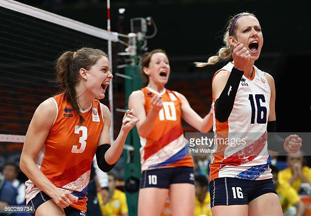 Debby StamPilon Lonneke Sloetjes and Yvon Belien of Netherlands celebrate a point during the Women's Bronze Medal Match between Netherlands and the...