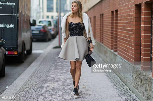 Debi Fluegge wearing a mini skirt Stella McCartney shoes off shoulder top at Marina Hoermanseder during the MercedesBenz Fashion Week Berlin A/W 2017...