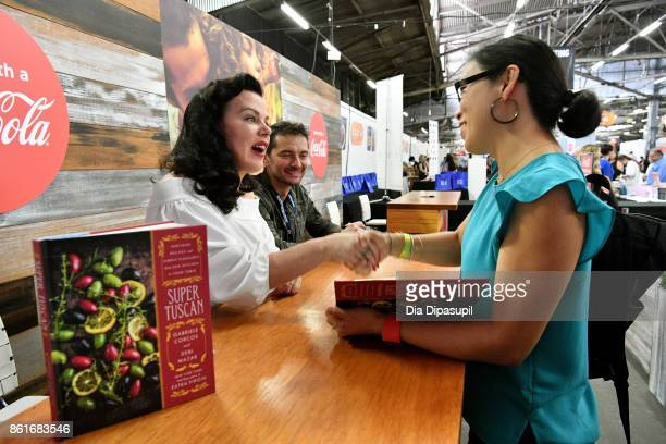 Debi Mazar and Gabriele Corcos sign their cookbook Super Tuscan Heritage Recipes and Simple Pleasures from Our Kitchen to Your Table at the Food...