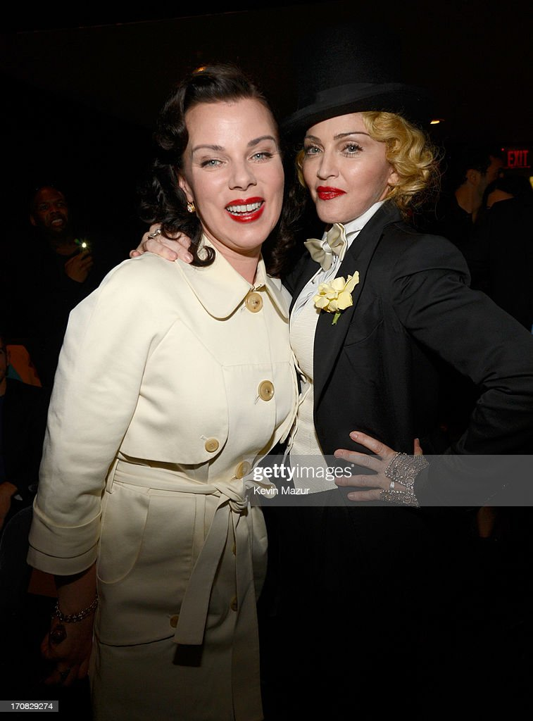 Debi Mazar and Madonna attend the Dolce & Gabbana and The Cinema Society screening of the Epix World premiere of 'Madonna: The MDNA Tour' at The Paris Theatre on June 18, 2013 in New York City.