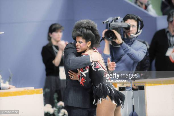 Debi Thomas of the USA hugs her coach Alex McGowan after skating her Long Program of the Women's Singles event of the Figure Skating competition of...