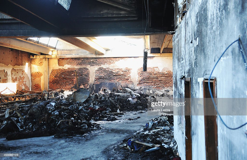 Debis sits inside a burned interior of a clothing factory after a fire where seven Chinese workers were burned to death on December 4, 2013 in Prato, Italy. Seven people died and three were injured December 1, when a Chinese clothing factory in the industrial district of the Italian town of Prato in Tuscany burned, killing the workers trapped in a factory dormitory, where workers sleep, eat, and work.